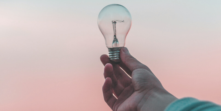 hand holding lightbulb understand your personal brand